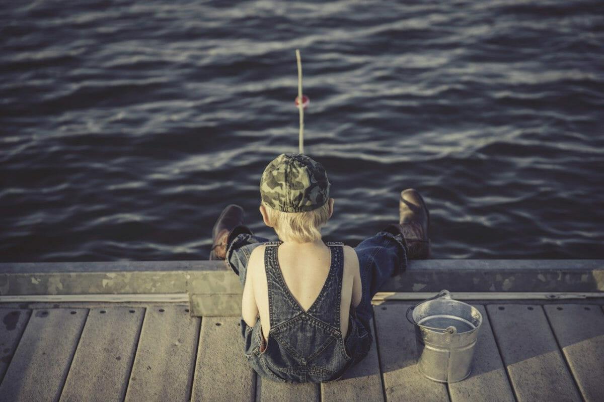 Boy fishing off a dock